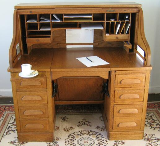 desk while keeping several books and documents then a roll top desks