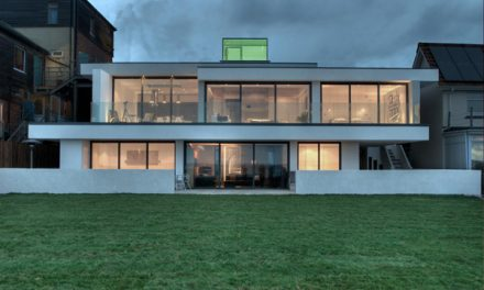Lighthouse Inspired Coastal Home in the UK by AR Design